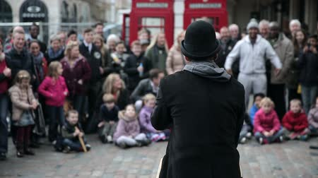 covent : street artist in front of cheering crowd in london