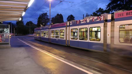 kolej : Trams in Zurich in motion at night Wideo