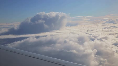 outside view : flying above the sky and looking outside the window of airplane