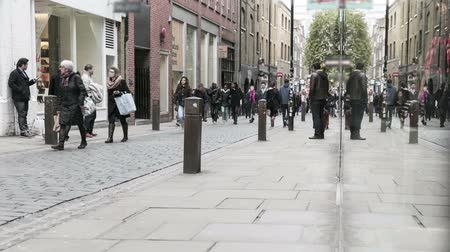 covent : time lapse of people walking and shopping in covent garden and surrounded areas