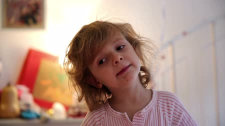 cozy : A little girl snacks some cookies with a satisfied grin on bits advent First Stock Footage