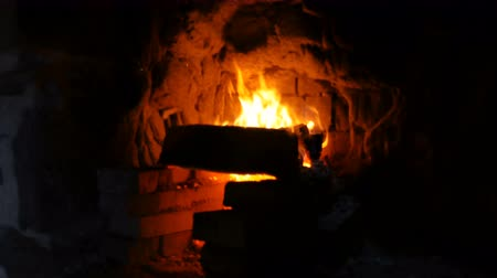 ember : A fire burns in a hearth at a smiths forge. Close up.