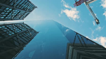 worms eye view : Modern glass skyscrapers seen from the bottom looking up. Zoom out. Stock Footage