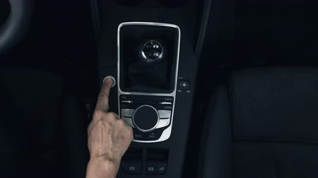 gearstick : A finger presses a cars start engine button. Close up. Overhead. Stock Footage