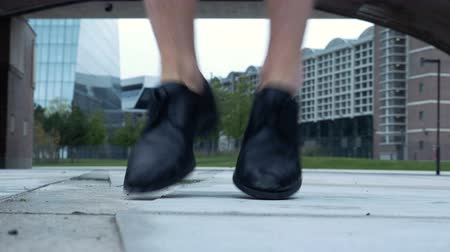 worms eye view : The black dress shoes of a male dancer as he dances. Worms eye view shot looking straight at the shoes and legs.