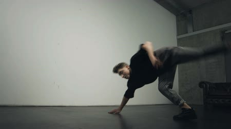 worms eye view : One hand freeze breakdance move performer by a young male dancer. Side view. Worms eye view.