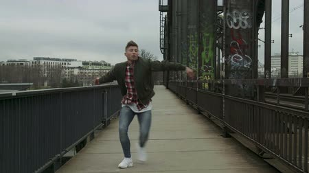 body building : An urban dancer performs a dance near railway tracks in Frankfurt, Germany. Full body shot. Stock Footage