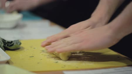 deska do krojenia : Slow motion cooking: hands rolling gnocchi dough. Close up. Slow motion. Hands only. Wideo