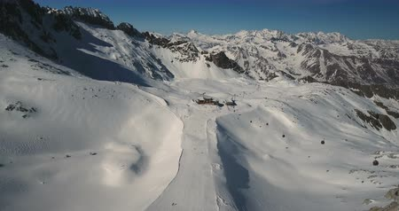télen : Ski slope activity at the Passo del Tonale in Italy. Extreme wide shot. Panorama. Drone shot.