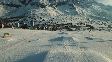 домик : Paso del Tonale resort and mountain peaks. Drone shot.