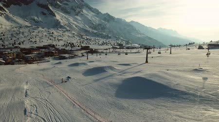 snowboard : Paso del Tonale resort and mountain peaks. Drone shot.