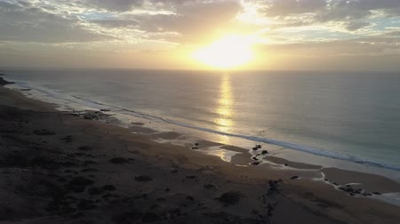 Sunset over a Canary Islands beach. Drone shot.