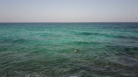Seascape and waves at Fuerteventura, Canary Islands. Horizon over water. Aerial shot. Stok Video