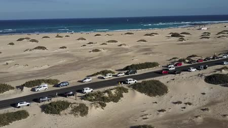 Canary Islands beach panorama. Cars parked on road between sands. Drone view. Stok Video