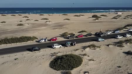área de deserto : Canary Islands beach panorama. Cars parked on road between sands. Aerial view.