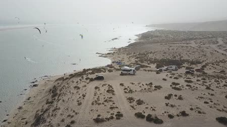 Aerial panorama of kites dotting the shores of Fuerteventura, Canary Islands. Drone shot.