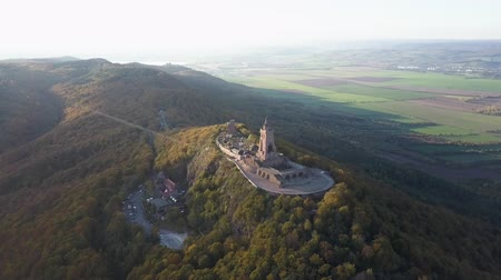 Drone view of the Kyffhauser monument. Horizon over land in the distance.