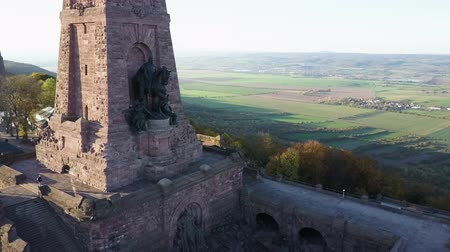 Emperor William sculpture at the Kyffhauser Monument in Germany. Details of the statue and landscape panorama. Drone shot.