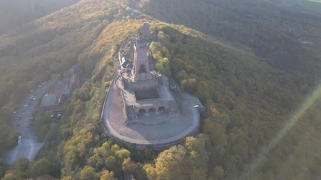 Kyffhauer monument in Thuringia Germany. Overhead of castle ruins to birds eye view of the monument atop the mountains. Drone shot.