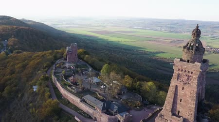 william : Kyffhauser monument in Thuringia, Germany. Flying around the mountain and looking towards rural landscape. Drone shot. Panorama.