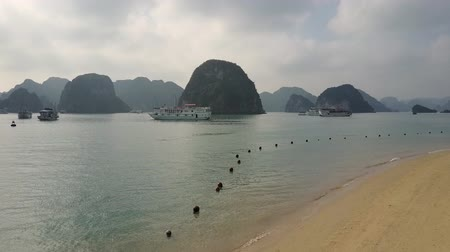 Sandy beach to karst hill island formations and mountain silhouettes. Stok Video