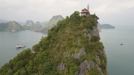 ha : Karst Peak and Gazebo in Ha Long Bay, Vietnam. Drone shot.