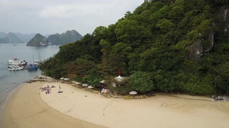 ha : Drone panorama of Ha Long Bay, Vietnam. Descending drone towards beach sands.