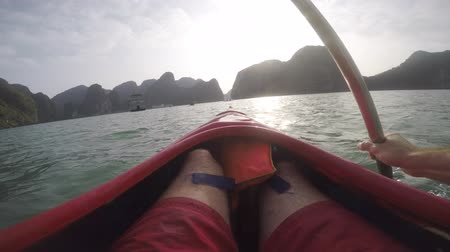 Kaying POV in Ha Long Bay. Morning sunlight glimmering overs the water. Stock mozgókép