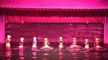 um objeto : Vietnamese water puppetry show. Puppet men playing drums in the water. Stock Footage