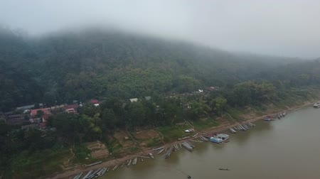 Misty horizon over the Mekong River in Laos. Aerial view. Stok Video
