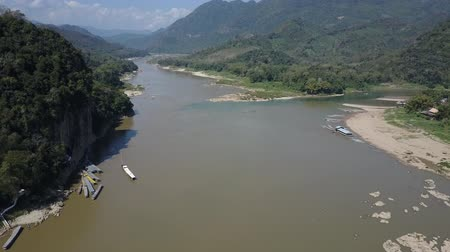 Establishing aerial shot of the Mekong River and the surrounding mountains. Vanishing point. Drone shot.