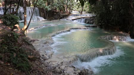 prabang : Turquoise waterfall pools in lush tropical forest.