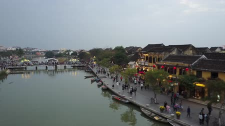 hoi an : Hoi An city riverfront scenery. People enjoying the sites of the historical Vietnamese city. Drone shot. Vanishing point.