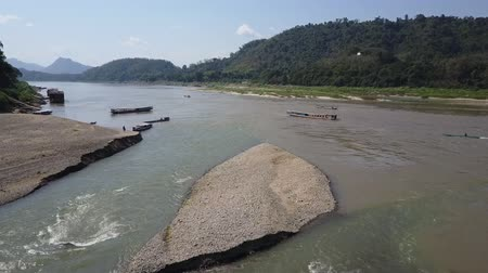 sail rock : Drone shot across flying from a tributary of the Mekong River. Vanishing point. Stock Footage