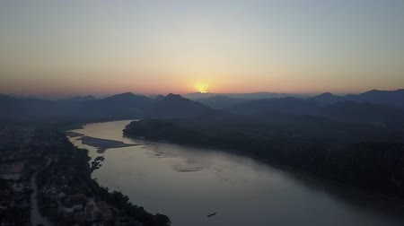 prabang : Sunset over the Mekong River in Laos. Drone shot.