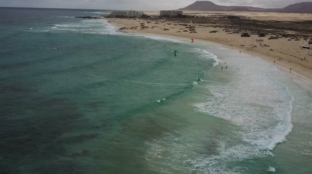 fuerteventura : Aerial panorama of kitesurfing activity in Fuerteventura, Canary Islands. Resorts, mountains, sandy shores with a horizon stretching over the oceans waters in the distance. Drone shot.