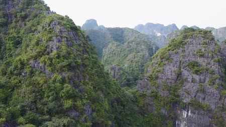 ninh : Flying over the peaks of limestone mountains in Ninh Binh, Vietnam. Drone shot.
