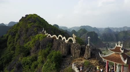 ninh : Lying Dragon Mountain with group of tourists.