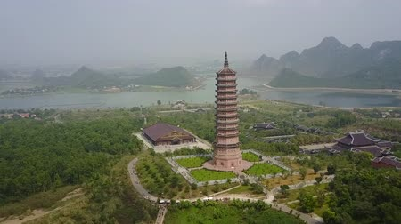 ninh : Bai Dinh pagoda with surrounding landscape. Aerial panorama of the famous religious building. Establishing shot.