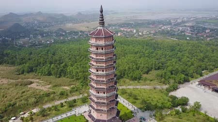 reserva : Pagoda aerial with surrounding landscape and horizon in the distance. Ninh Binh, Vietnam. Drone shot.