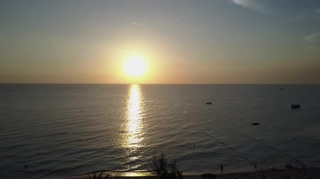 diminishing : Panorama of Sunset in the Gulf of Thailand With Distant Boat Silhouettes