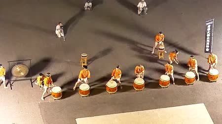Wide shot of a Japanese drum performance celebrating cruise leaving Wideo