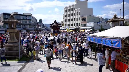 Wide shot of a Japanese drum performance celebrating a local festival