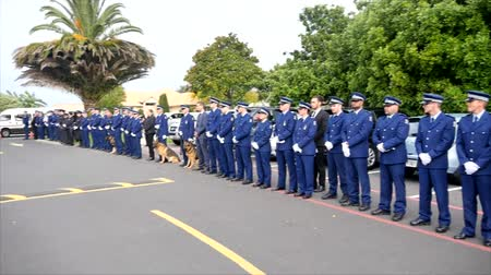psi : Shot of a funeral with police, dogs, motocycles & helicopter as guard of honor