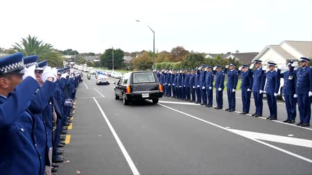 hearse : Shot of a funeral with police, dogs, motocycles & helicopter as guard of honor