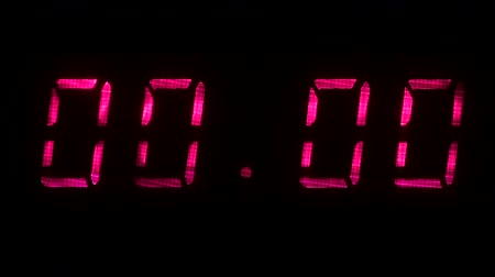 fósforo : Digital clock with fluorescent display shows 00:00 in yellow color on a black background
