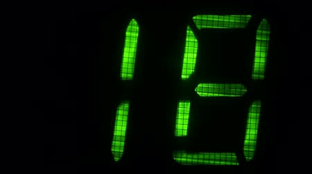 fósforo : Fluorescent display countdown self-destruction timer in green and red color over black background