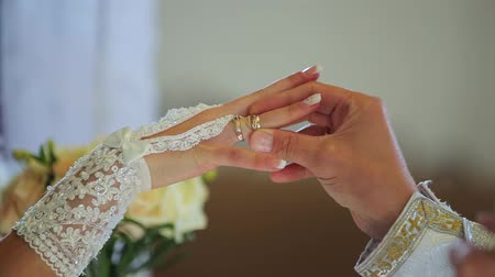 ring : closeup of bride exchanging wedding rings Stock Footage