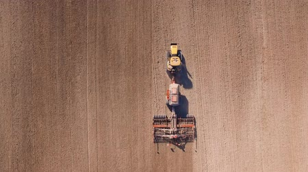 irrigate : Aerial of tractor on harvest field top view from height