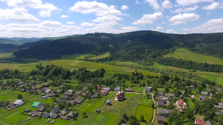 yalıtım : Aerial shoot of the houses and the vilage. Aerial fly over shoot of the village on the countryside in Ukraine Stok Video